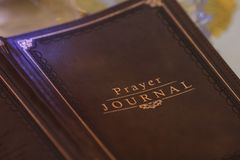 Write your prayers in a journal. We pray, for love, hope and faith. Write them down and remember what you prayed for royalty free stock photo