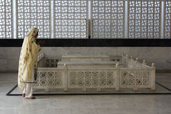 Pray at Mausoleum. Poor woman prays at mausoleum of begum Rana Liaqat Ali Khan Karachi, Pakistan Royalty Free Stock Photography