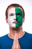 Pray for Northern Ireland. Northern Irishman football fan pray for national team Royalty Free Stock Photo