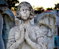 Pray. An old angle sculpture in the local cemetery shot using Nikon D3100 18-55mm kit lens Royalty Free Stock Image