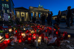 Pray for Orlando. BERLIN - JUNE 20, 2016: Pray for Orlando. Candles in memory of the victims of the shooting at the club Pulse in Orlando, near the US Embassy on Royalty Free Stock Photos