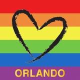 Pray for Orlando. Black heart shape on rainbow flag background. Stock Photo