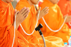 Pray, Put the palms of the hands together in salute , monks Stock Image