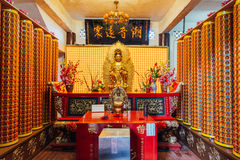 Pray room of the Kek Lok Si Temple is a Buddhist temple in Penang, and is one of the best known temples on the island. Royalty Free Stock Photo
