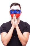 Pray for Russia. Russian football fan pray for game Russia national team Stock Images