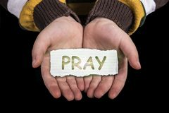 Pray text on hand Royalty Free Stock Image