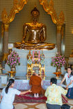 Pray time. Thailand, september 2011 - Monk and some local people during pray time in a temple, Thailand Stock Photos