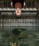 Pray to be prey. Man being tied up in Alligator`s tank,3d rendering stock illustration