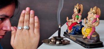 Pray to god. Girl pray to lord Ganesha Royalty Free Stock Photo