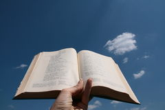 Pray to heaven. Open bible in heand, pslam Royalty Free Stock Photos