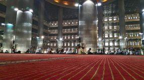 Pray to Heaven. Main Hall in Istiqlal Mosque, the biggest mosque in Southeast Asia Stock Photos