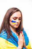 Pray of Ukraine. Ukrainian football  girl fan pray for game Ukraine Stock Photos
