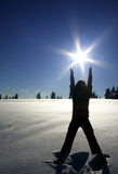 Pray for Warmth. A woman worships the warmth of the sun on a cold winter day Royalty Free Stock Image