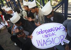 Pray for Wasior. Number of student doing pray to victim of the wasior earthquake in solo, central java, indonesia Royalty Free Stock Photo