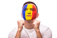Pray and wish for win Romanian football fan in game  of Romania national team. On white background. European football fans concept Stock Photo