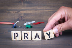 Pray. Wooden letters on dark background. Pray. Wooden letters on dark texture background Royalty Free Stock Photography