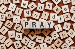 Pray word concept royalty free stock photography
