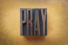 Pray. The word PRAY written in vintage letterpress type stock image
