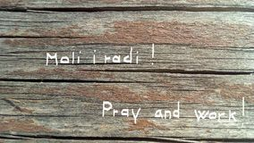 Pray and work Stock Photos