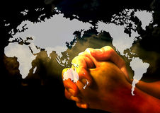 Pray for the world. Praying hands for the world Royalty Free Stock Photography