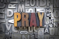 Pray. Written in vintage letterpress type Royalty Free Stock Photography