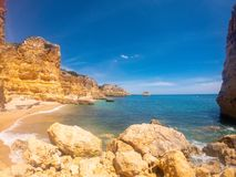 Praya de Marinha most beautiful beach in Algarve, Portugal. Cliffs on Coast of Atlantic ocean against blue sky royalty free stock images