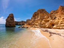 Praya de Marinha most beautiful beach in Algarve, Portugal. Cliffs on Coast of Atlantic ocean against blue sky royalty free stock photography