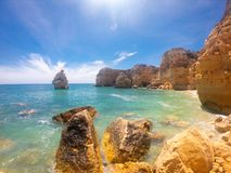 Praya de Marinha most beautiful beach in Algarve, Portugal. Cliffs on Coast of Atlantic ocean against blue sky royalty free stock image