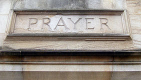 Prayer. The word PRAYER carved into stone over the entrance of a church Royalty Free Stock Photography