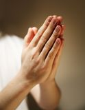 Prayer. Hands clasped in a prayer Stock Photography