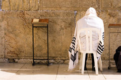 Prayer. A religious orthodox Jew wearing a prayer shawl draped prays at the Wailing Wall. Jerusalem, Israel Royalty Free Stock Photography