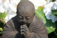 Prayer. A buddha statue devout in prayer stock photos