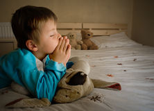 Prayer. Little boy praying at bedtime Royalty Free Stock Photo