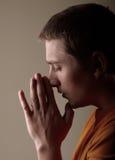 Prayer. Young man praying. studio shot Royalty Free Stock Photo