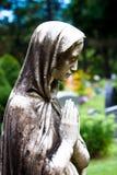 A Prayer. The Virgin Mary Statue praying in a garden Stock Photo