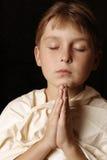Daily Prayer. Child in prayer Stock Image