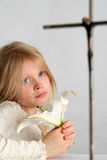 Prayer. Little girl praying on the easter lilies background Stock Photos