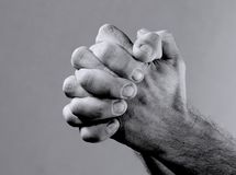 Prayer. Closeup from a man's hand while praying Stock Image
