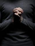Prayer. Vertical image of praying man Stock Photography