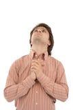 Prayer. Young man praying. White background Royalty Free Stock Photo