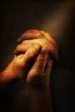 Prayer. S hands and sunbeam on old nostalgic background Stock Photography