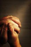 Prayer. S hands and sunbeam on old nostalgic background Stock Image
