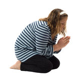 Prayer. A young girl saying her bedtime prayer, isolated against a white background Royalty Free Stock Photo