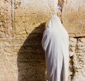 Prayer. A religious orthodox Jew wearing a prayer shawl draped prays at the Wailing Wall. Jerusalem, Israel Stock Image