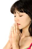 Prayer. Portrait of a beautiful girl in prayer