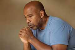 Prayer. African American in deep thought and prayer Stock Photos