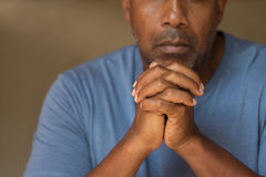 Prayer. African American in deep thought and prayer royalty free stock photos