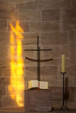 Prayer alcove with cross, book and candle Stock Photography