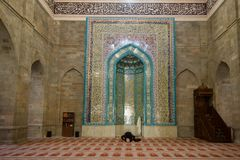 Prayer in the ancient Juma mosque. Shemakha. SHEMAHI, AZERBAIJAN - JANUARY 03, 2018: Prayer in the ancient Juma mosque stock images
