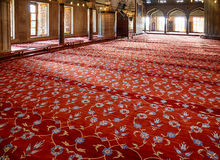 The prayer area covered with red carpets in Sultan Ahmed Mosque Stock Photos